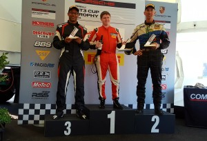 Steve Miller on the podium with TRG Porsche
